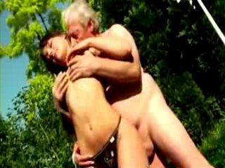 Tight ass bitch gets cock gobbling on old man dick outdoors