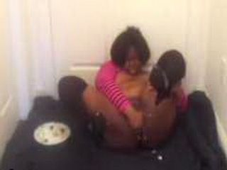Kinky black babe stuffs food in her big booty
