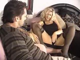 Busty blonde milf fucking in sexy black stockings
