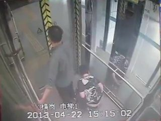 Woman Taped Shitting In Elevator While her Husband Guards Elevator Door Hilarious