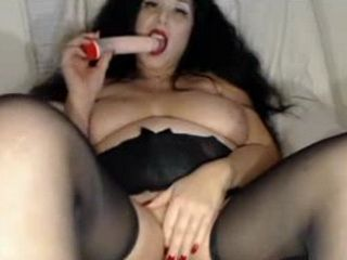 Mature with big tits toys her horny pussy on webcam