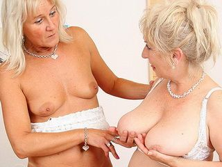 Well-endowed grandma penetrates a milf