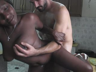 African big titted ebony girl was banged on the kitchen table by a white stud