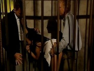 Locked Brunette Gets Fucked And Double Penetrated Behind The Bars
