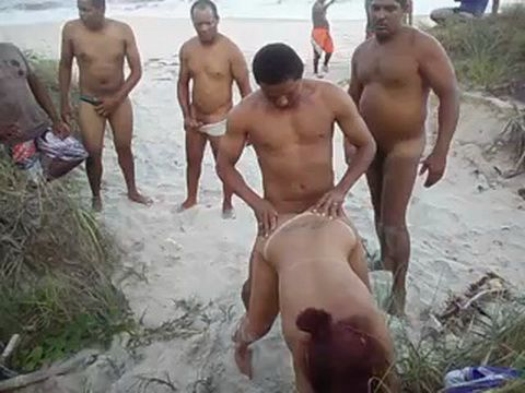 Group Of Mens Taking Turns On Hooker At The Beach