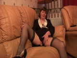 Granny in business suit and stockings showing hairy pussy