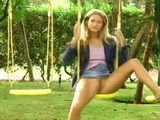 Girl Peeing on a Swing