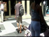 brunette in white pants bend over candid