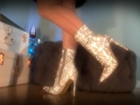 Sparkles Tease - Mesmerizing Goddess teases slaves in her Holiday Boots and uses a metronome