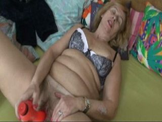 Old solo Granny play with a Toy in bed