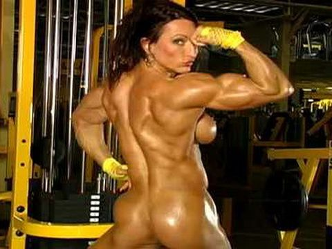 Hot Bodybuilder Flexes Her Muscle And Pussy At Guy