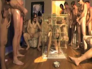 Humilated Girl in Cage Sucked Dozen Of Cocks In Bukakke Party