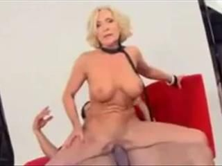 Busty Blonde Granny Seduces A Guy