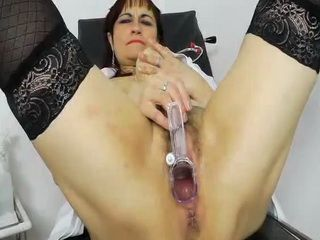 Redhead Remy sucks her fake cock at work