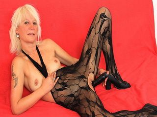 Blonde Mature Mom Fucking Herself Using a Dildo