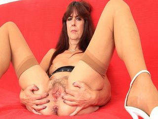 Ugly Mature Exposing Her Hairy Cunt and Masturbating