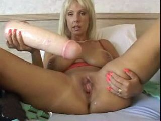 Mature Blonde Masturbate With Deadly Dildo Weapon