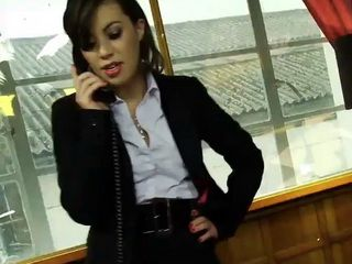 Tiffany Doll is a chic gorgeous business executive bored in her office