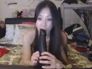 Asian Chokes On Monster Dildo