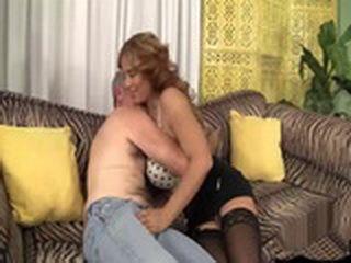 Mature Couple Having Sex On Sofa