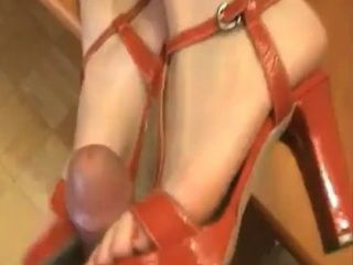 Super hot blonde milf gives a Footjob